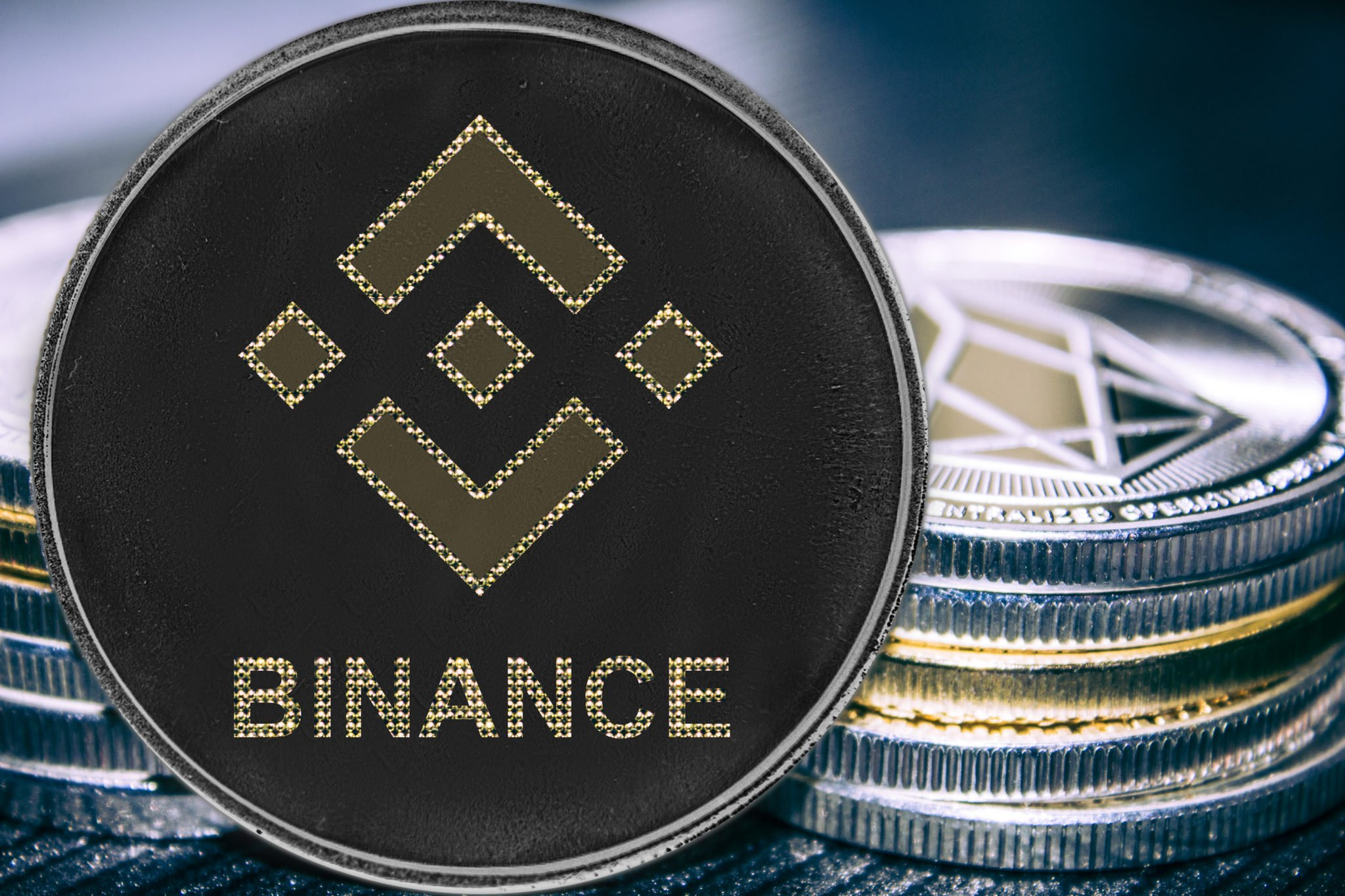 Coin cryptocurrency binance on the background of a stack of coins. BNB