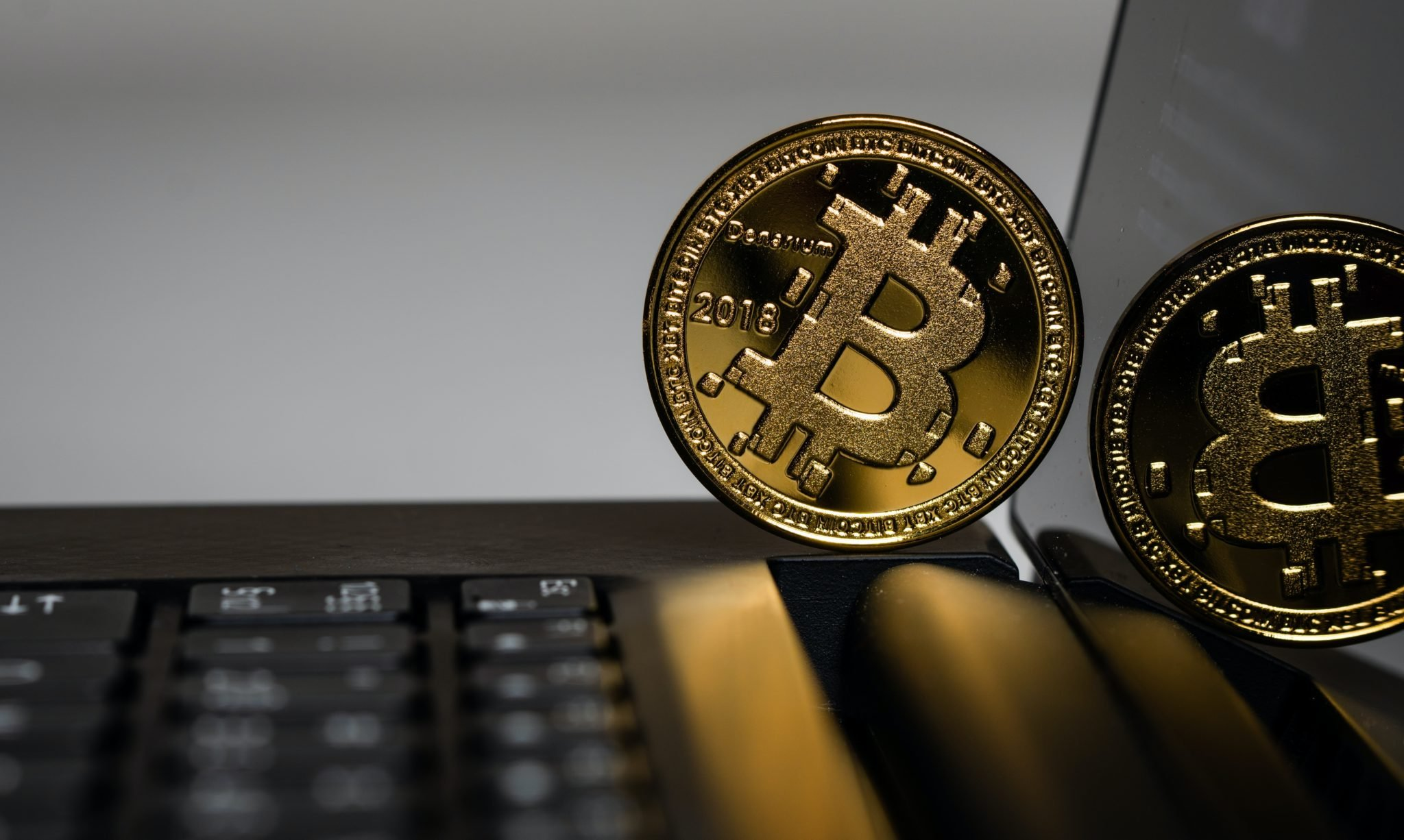 two gold Bitcoins