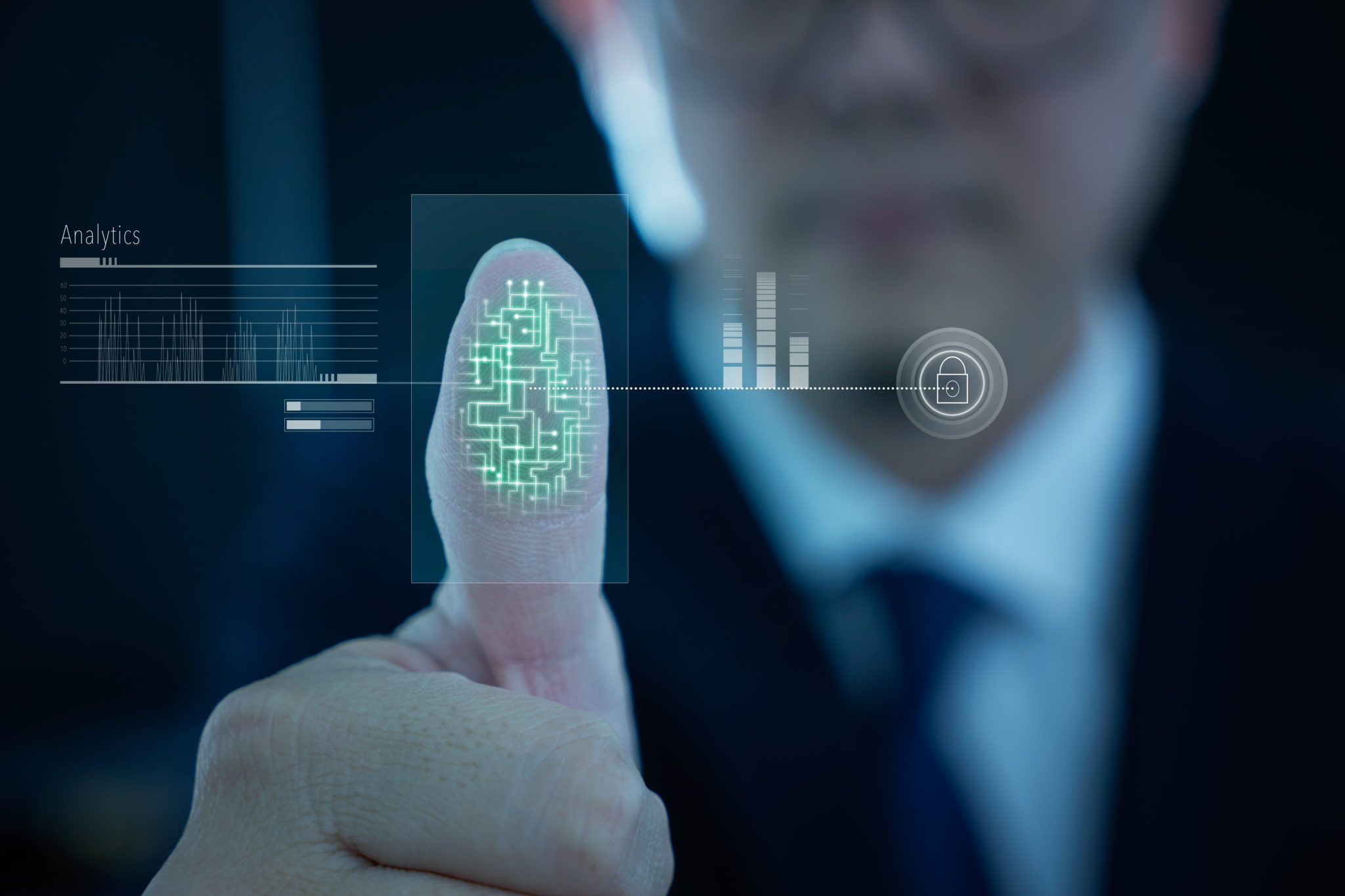 Young businessman scan fingerprint for identity analytics , concept of the internet and future immersive technology for business security .