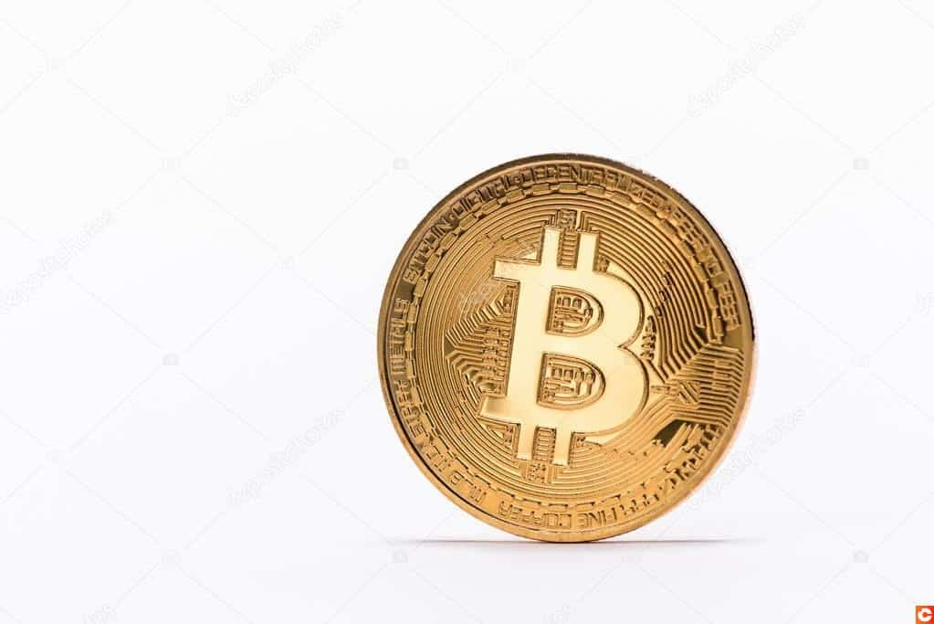 Close up view of golden bitcoin isolated on white
