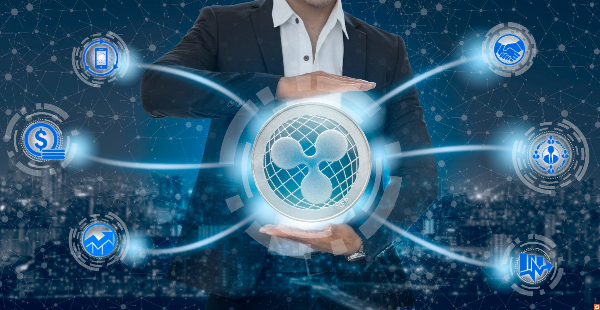 Ripple and cryptocurrency investing concept - Businessman holding Ripple (XRP) with mobile application business icons showing exchanging, trading, transfer and investment of blockchain technology.