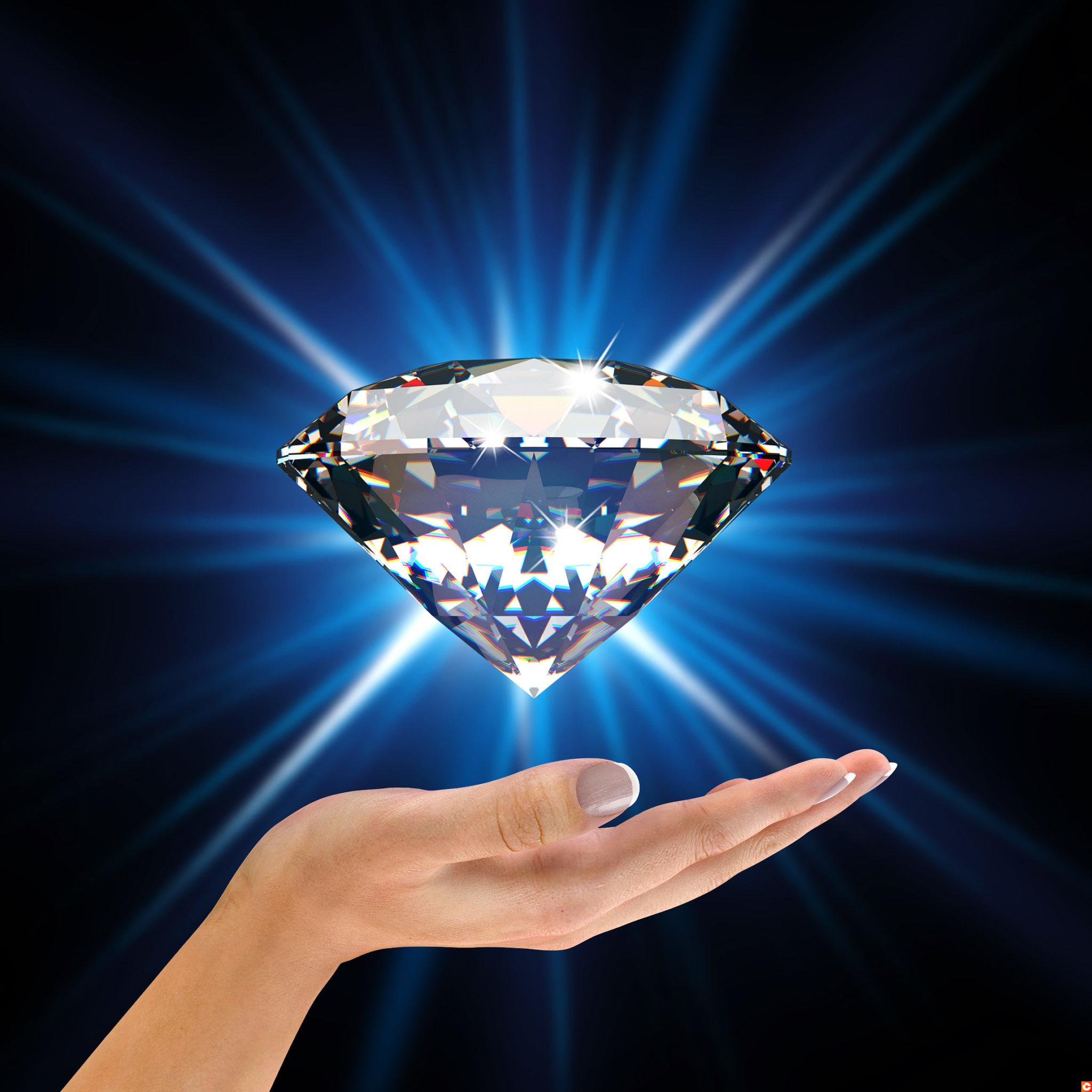 Blue diamond in hands