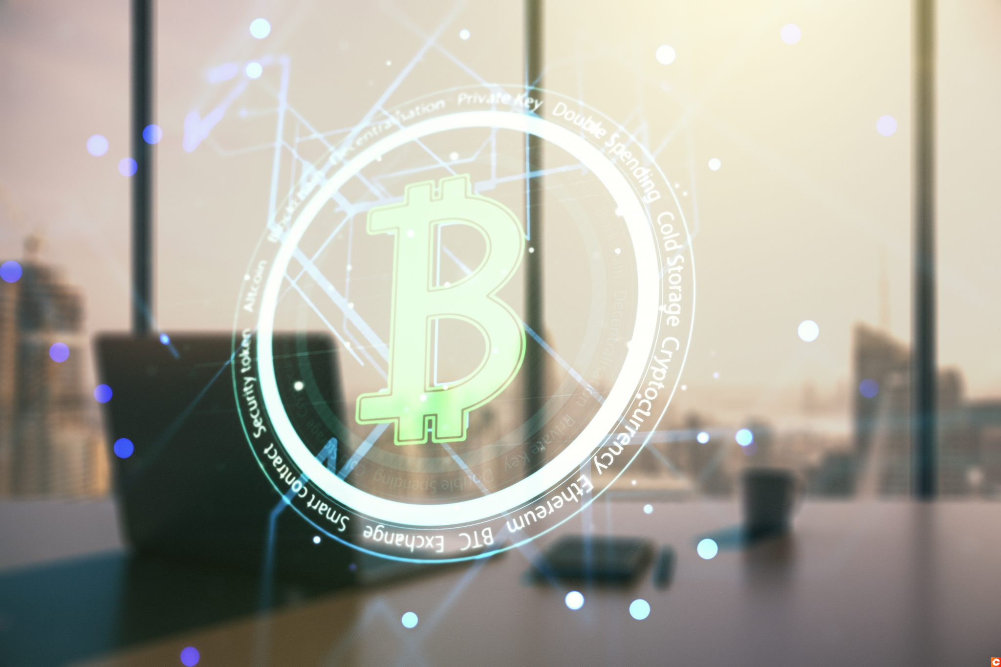 Double exposure of creative Bitcoin symbol hologram and modern desk with computer on background. Mining and blockchain concept