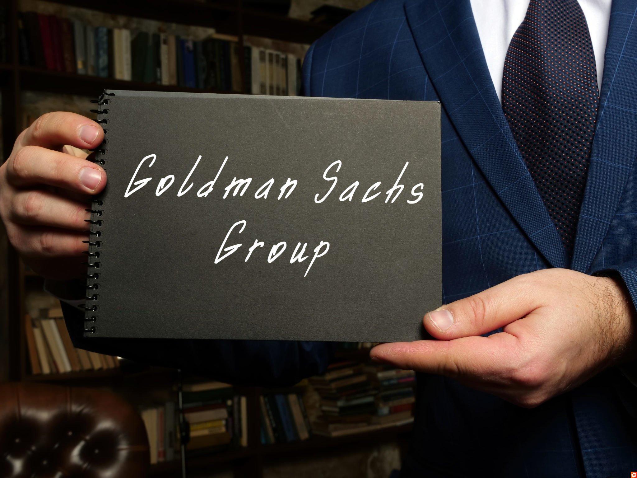 Goldman Sachs Group inscription on the black notepad