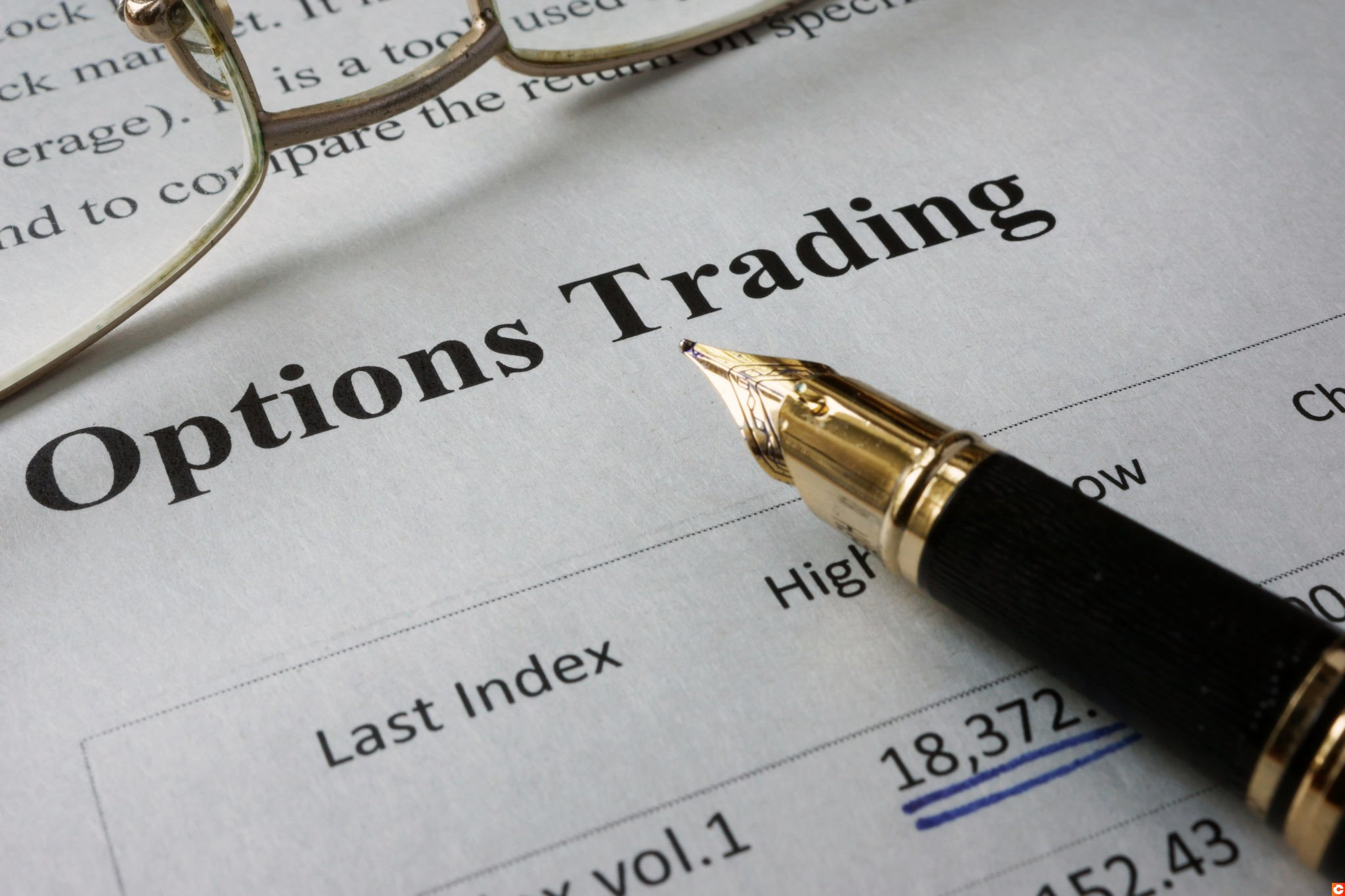 Page of newspaper with words options trading.