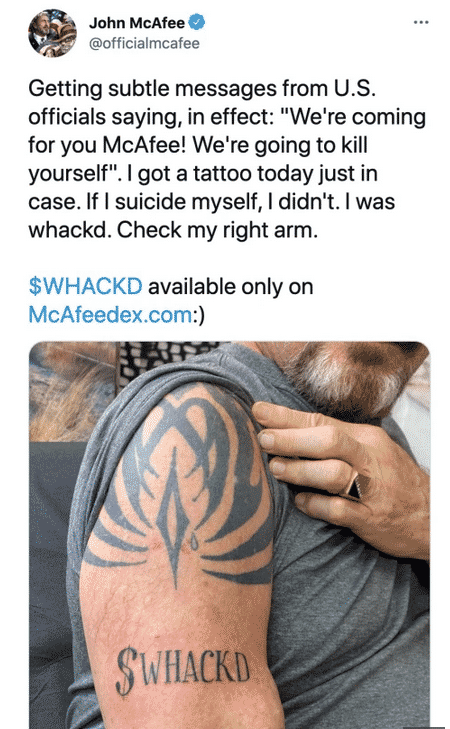 "John Mcafee showing his tatoo ""whackd"" in a tweet"