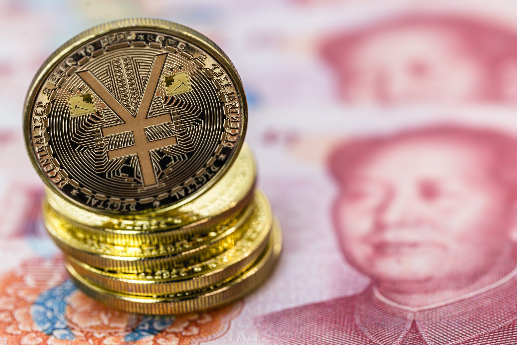 Chinese digital currency, conceptual image of the digital Yuan, or e-RMB, on old yuan banknotes