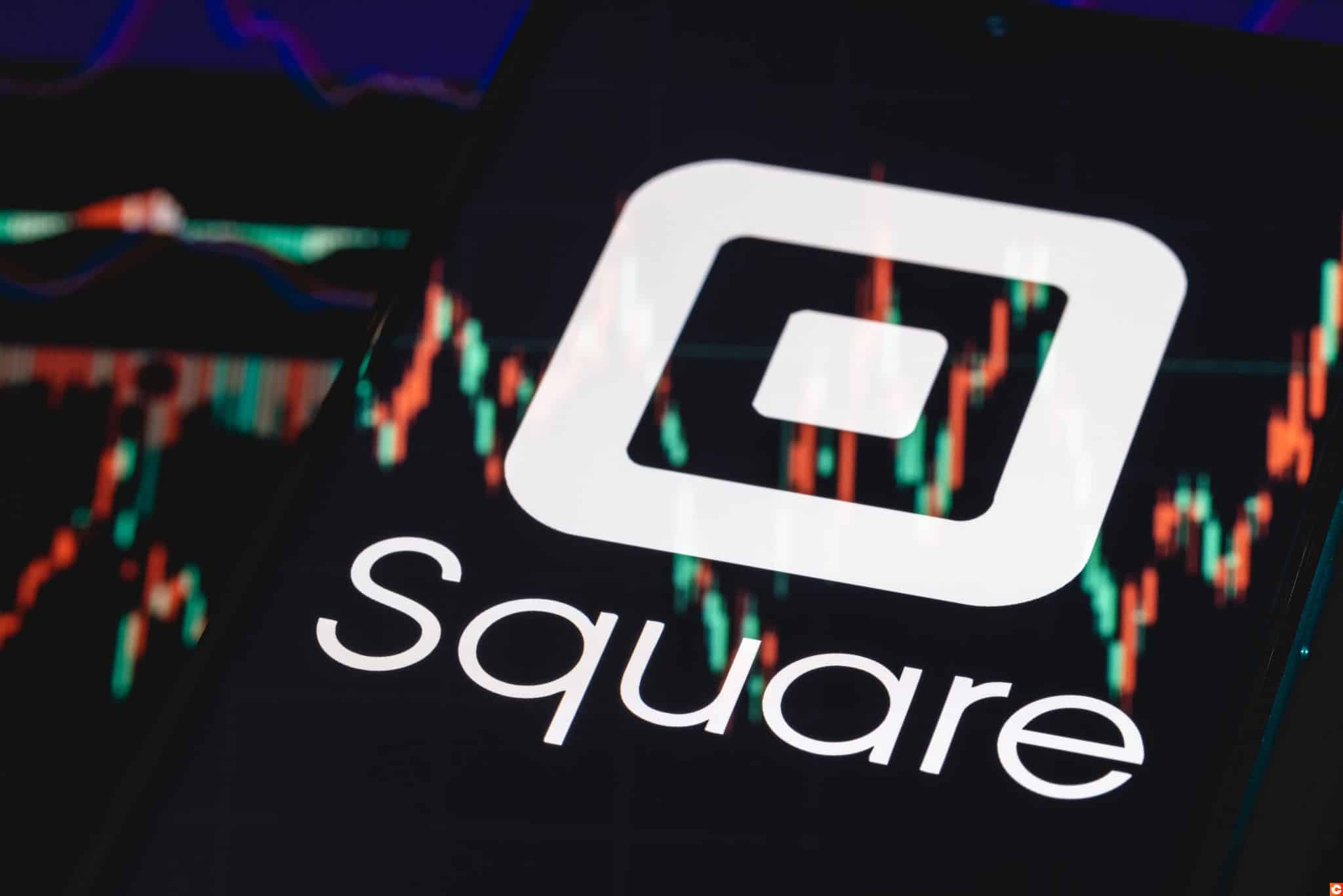 Kazan, Russia - May 30, 2021: Square is technology company that develops solutions for accepting and processing electronic payments. Square logo on smartphone screen. Stock chart in the reflection.