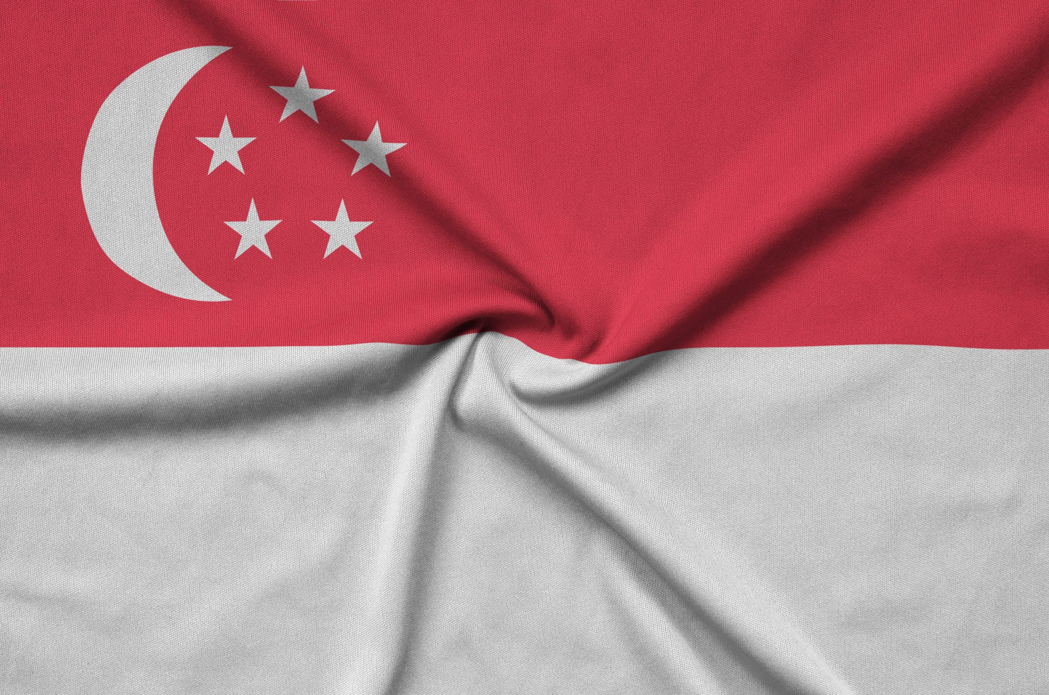 Singapore flag  is depicted on a sports cloth fabric with many folds. Sport team waving banner