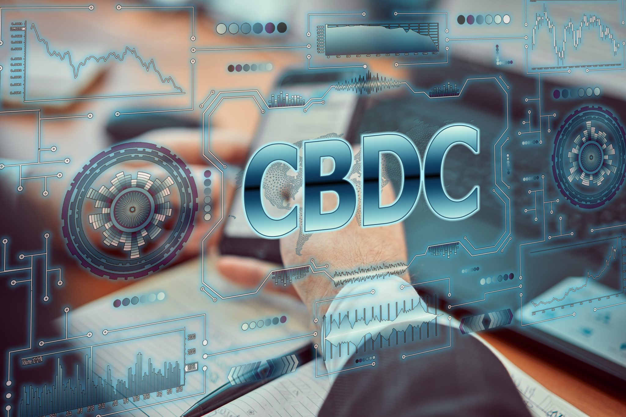 """A young businessman uses a futuristic smartphone with the latest holographic technology of augmented reality with the inscription """"CBDC"""". Central bank digital currency concept"""