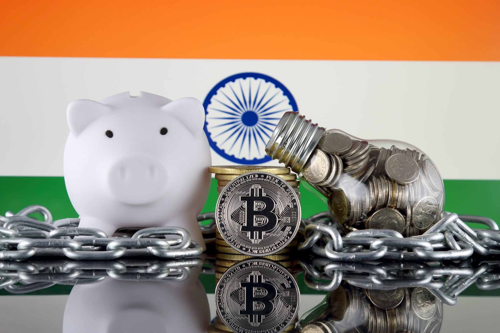 Bitcoin (BTC), Blockchain Technology, energy concept and India Flag. Electricity prices, energy saving in the cryptocurrency mining business.