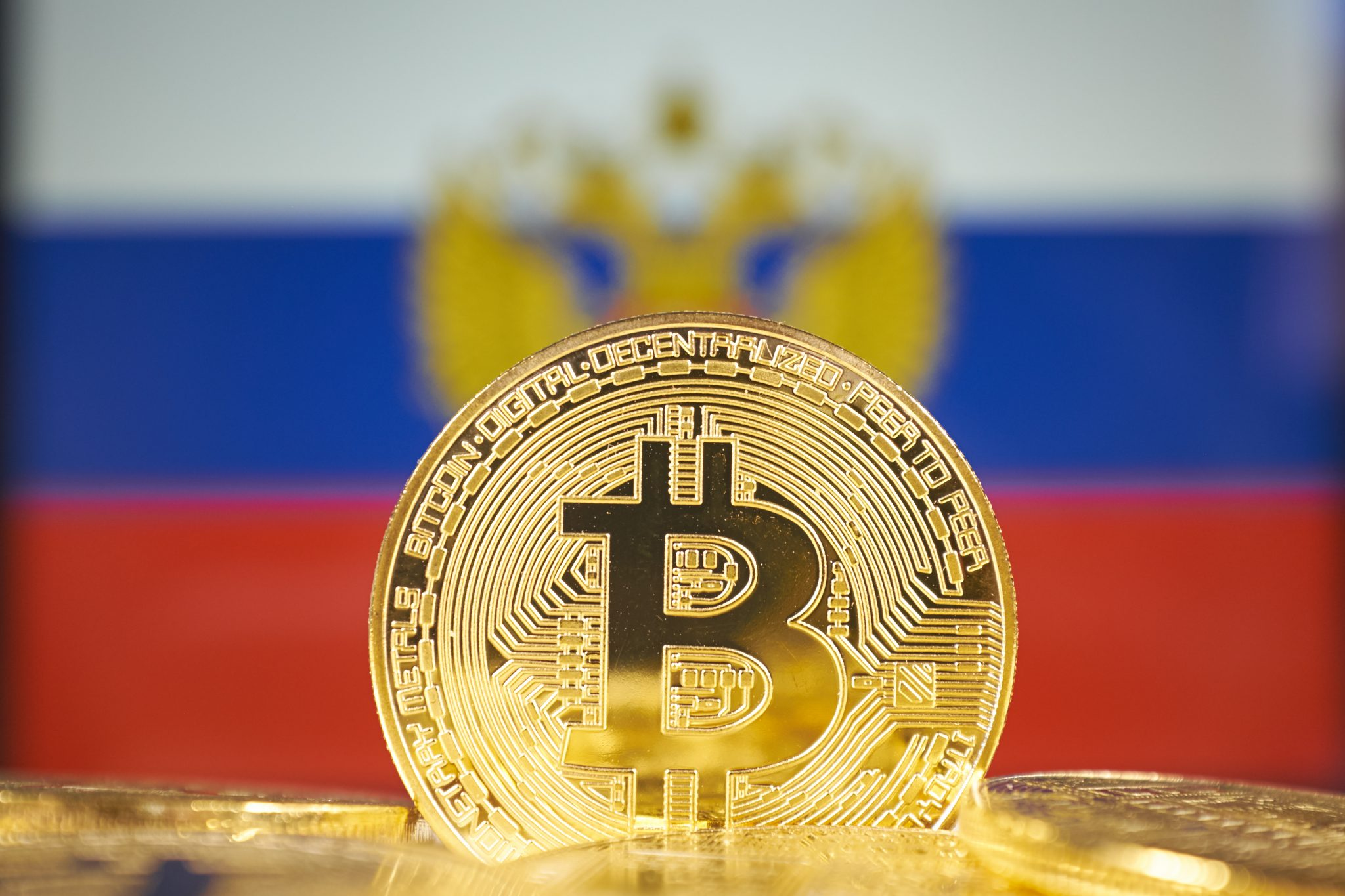 Bitcoin (new virtual money) and Russia Flag. Conceptual image for investors