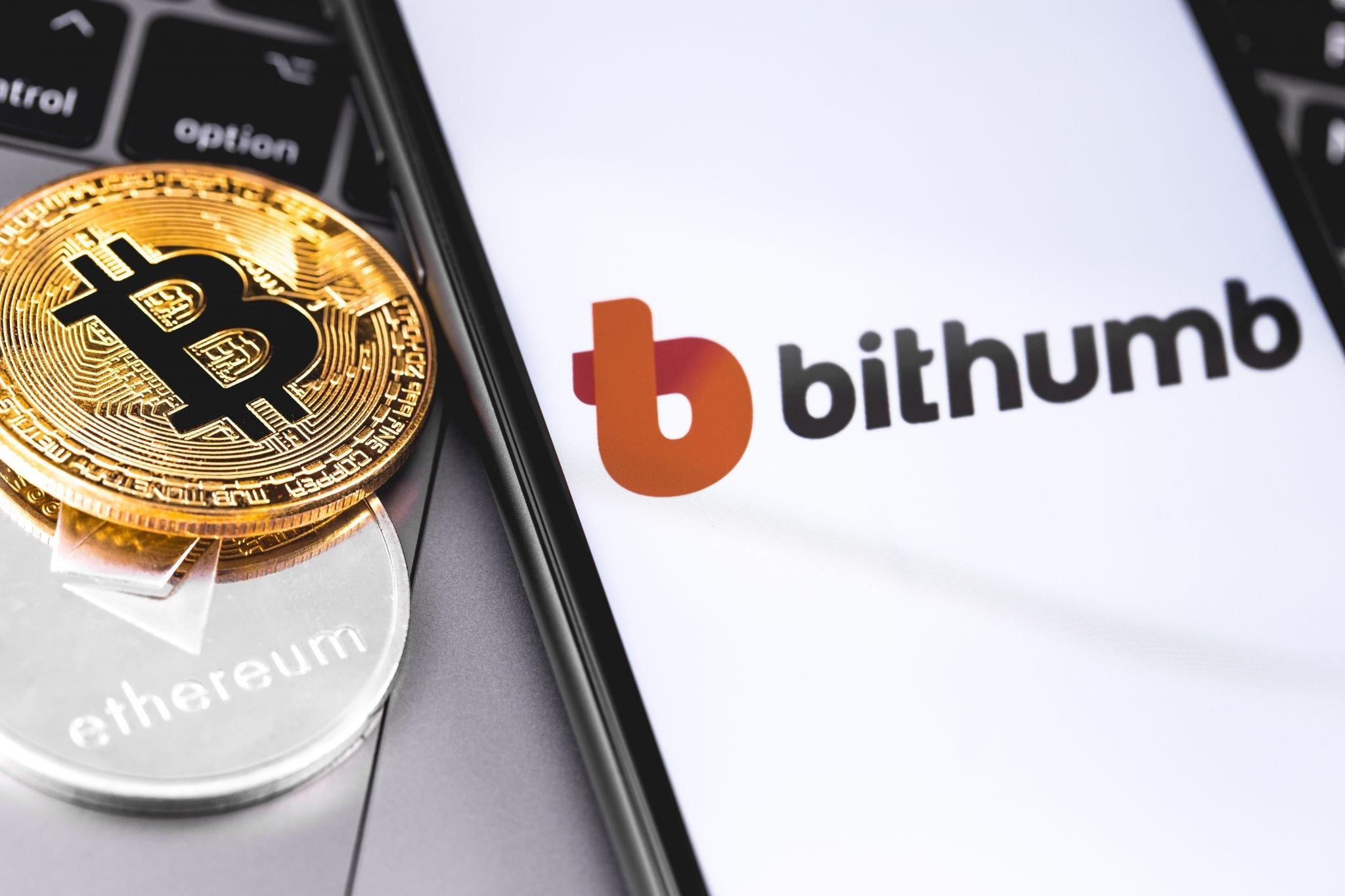 bitcoins, Bithumb logo of crypto-exchange on the screen smartpho