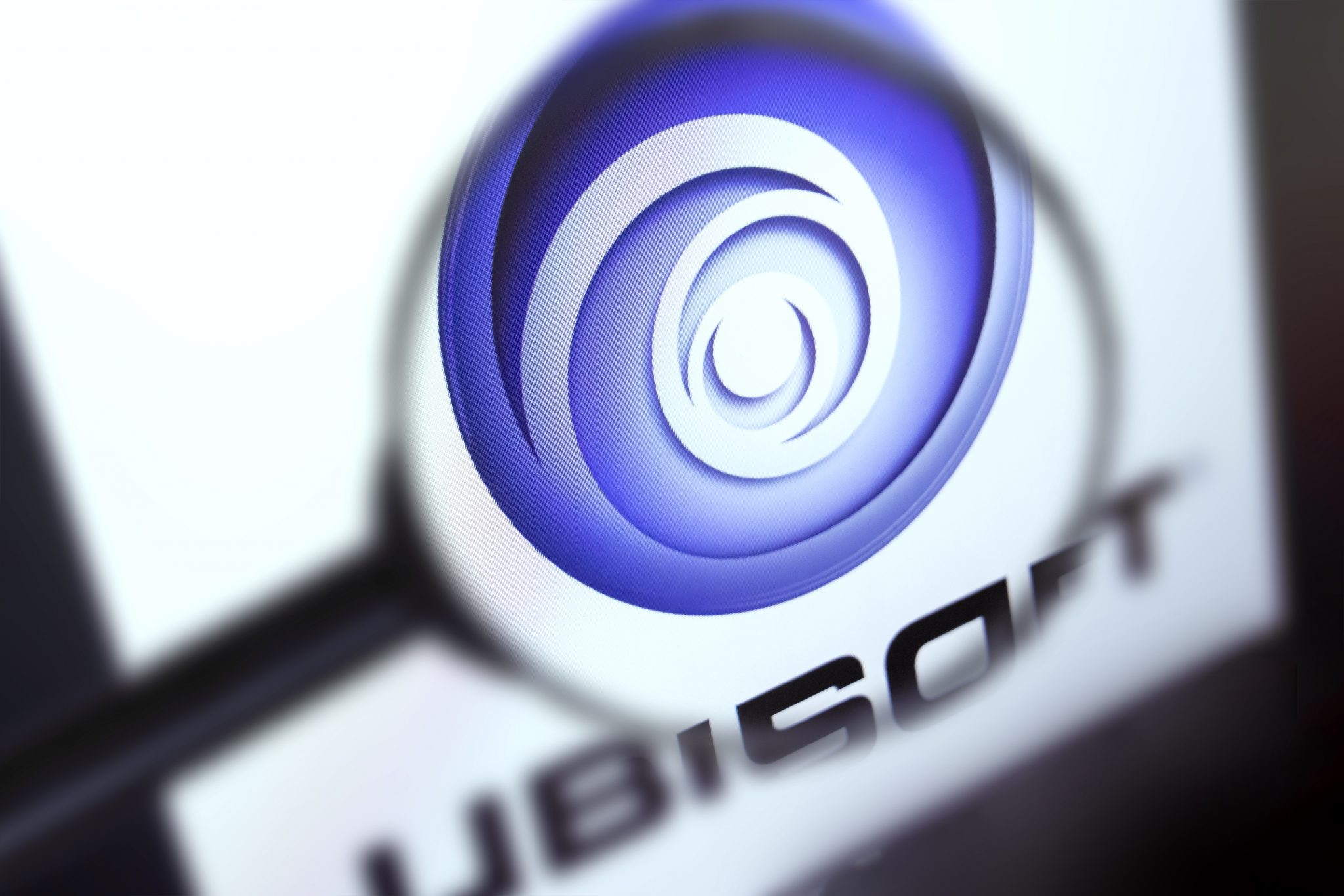 Brest, Belarus, March 15, 2019. Ubisoft home page, view through a magnifying glass. Ubisoft company logo is visible. Soft focus.