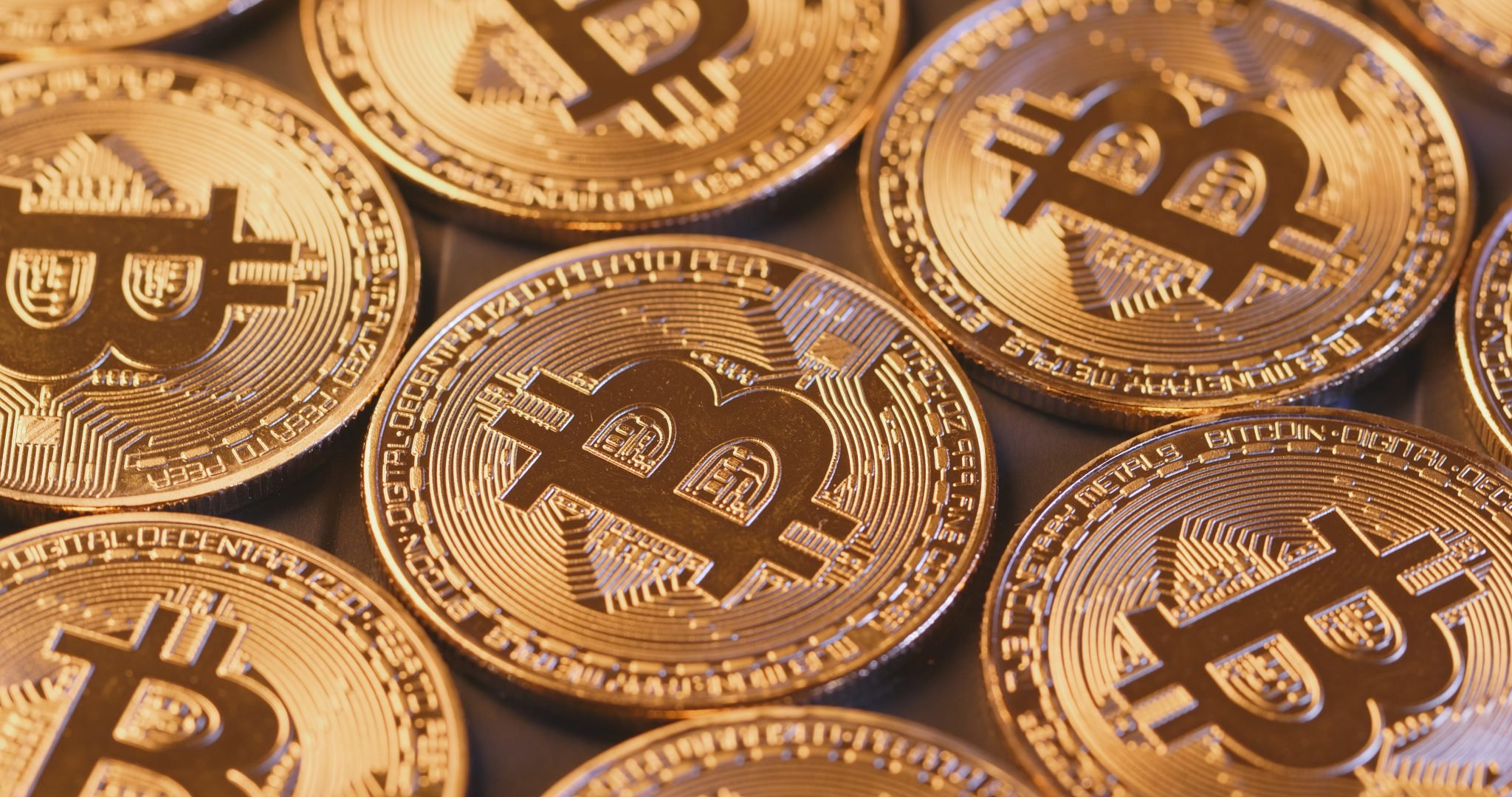 Golden Bitcoins in pile close up