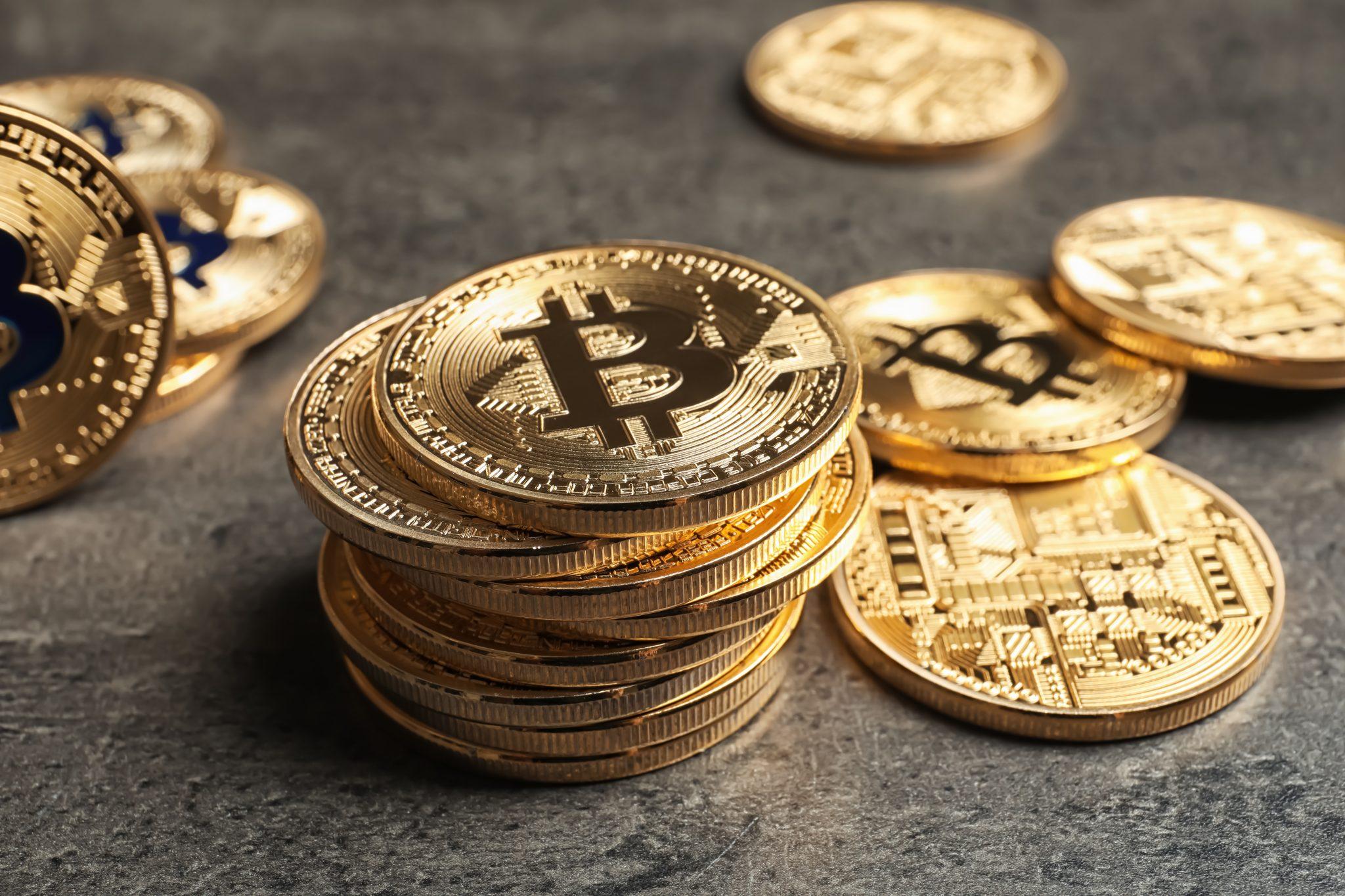 Golden bitcoins on grey