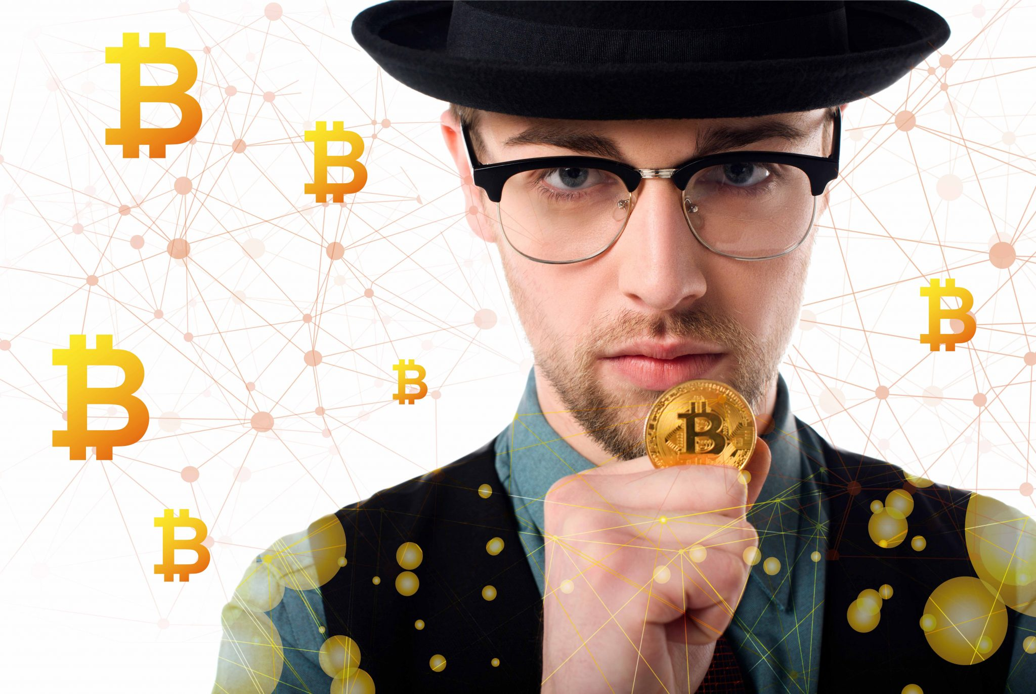 Portrait of man in eyeglasses and hat holding golden bitcoin on white