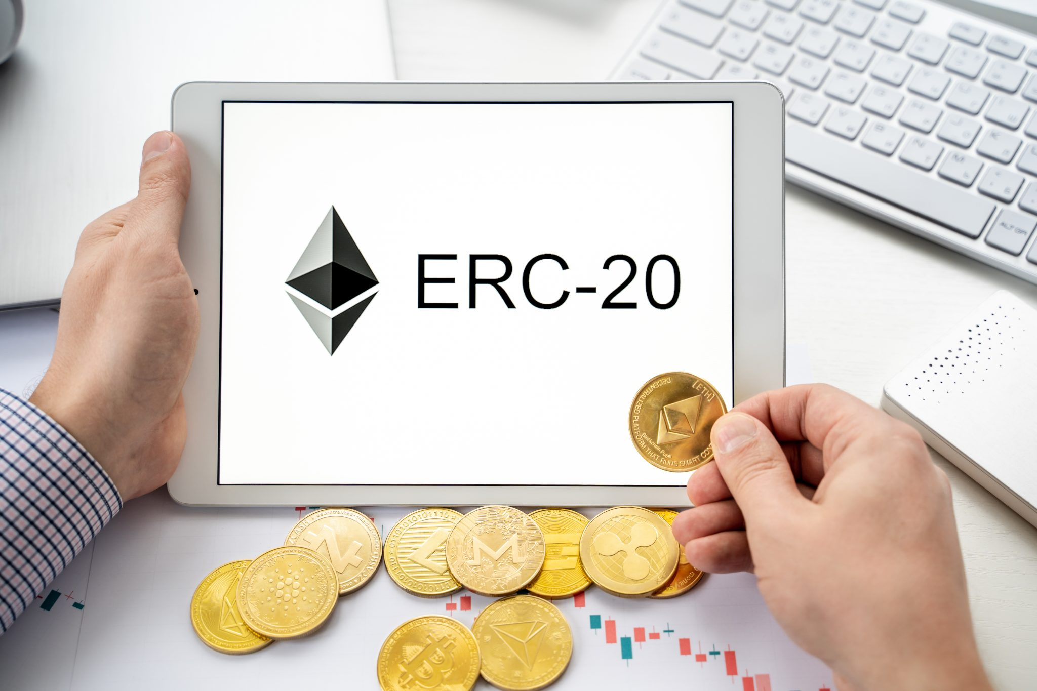 Russia Moscow 06.05.2021.Businessman holding tablet with logo of ERC-20 official protocol of Ethereum ETH network. Standard for creating tokens on Ethereum blockchain.