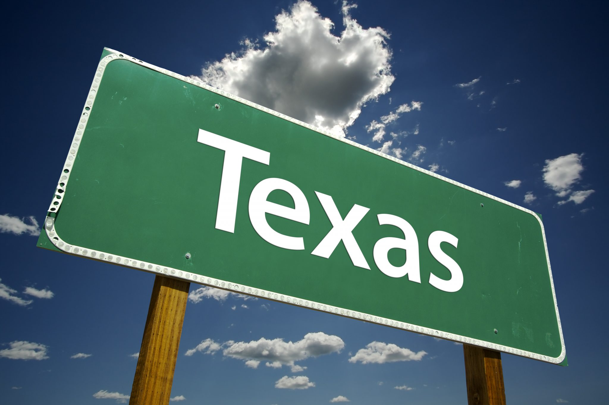 Texas Road Sign Over Sky and Clouds