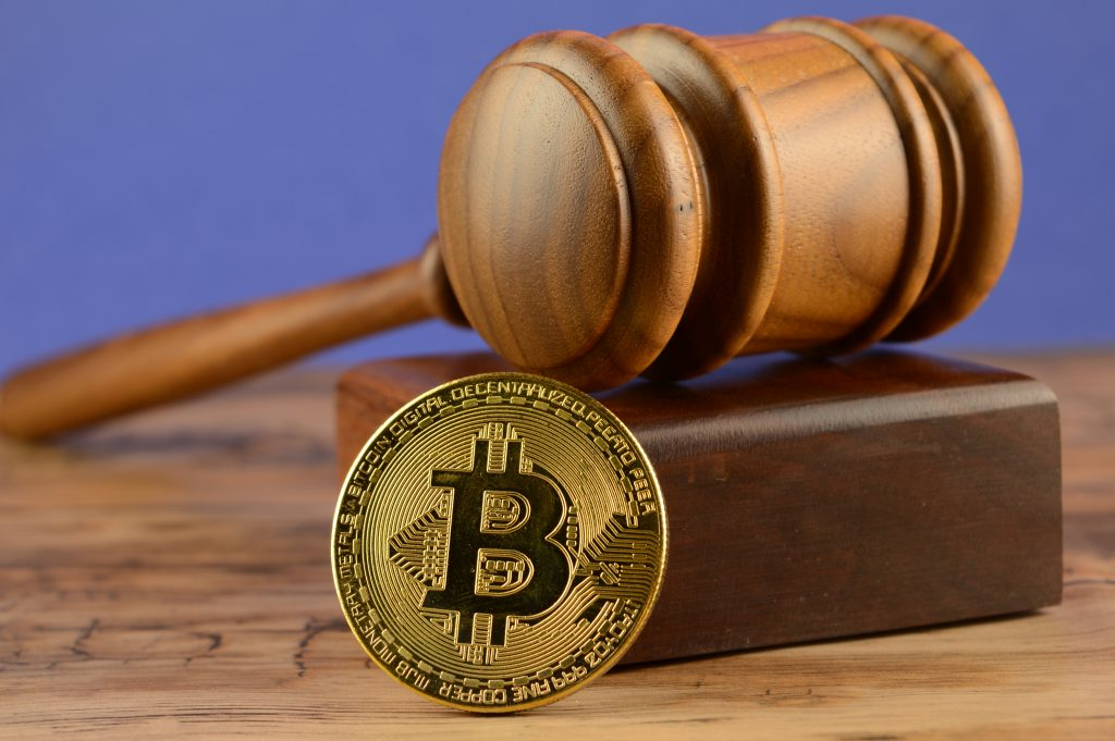A conceptual image for cryptocurrency laws and the legal system surrounding it.