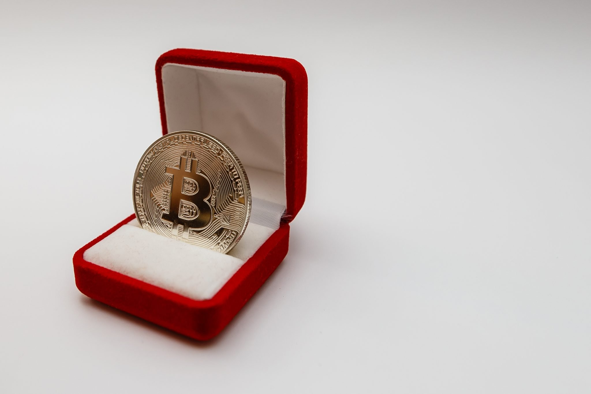 Coin bitcoin in a gift box for a ring or jewelry the concept of crypto currency, best gift concept