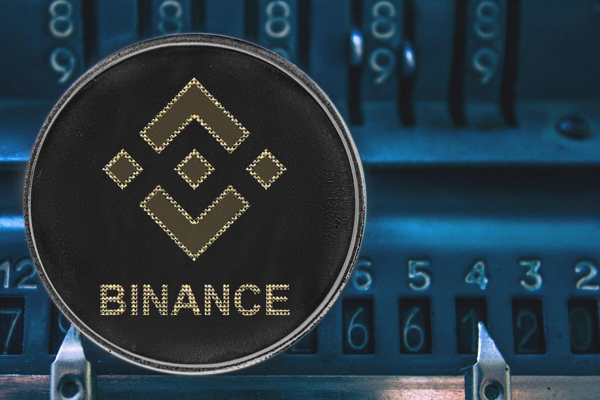Coin cryptocurrency bnb against the numbers of the arithmometer. binance