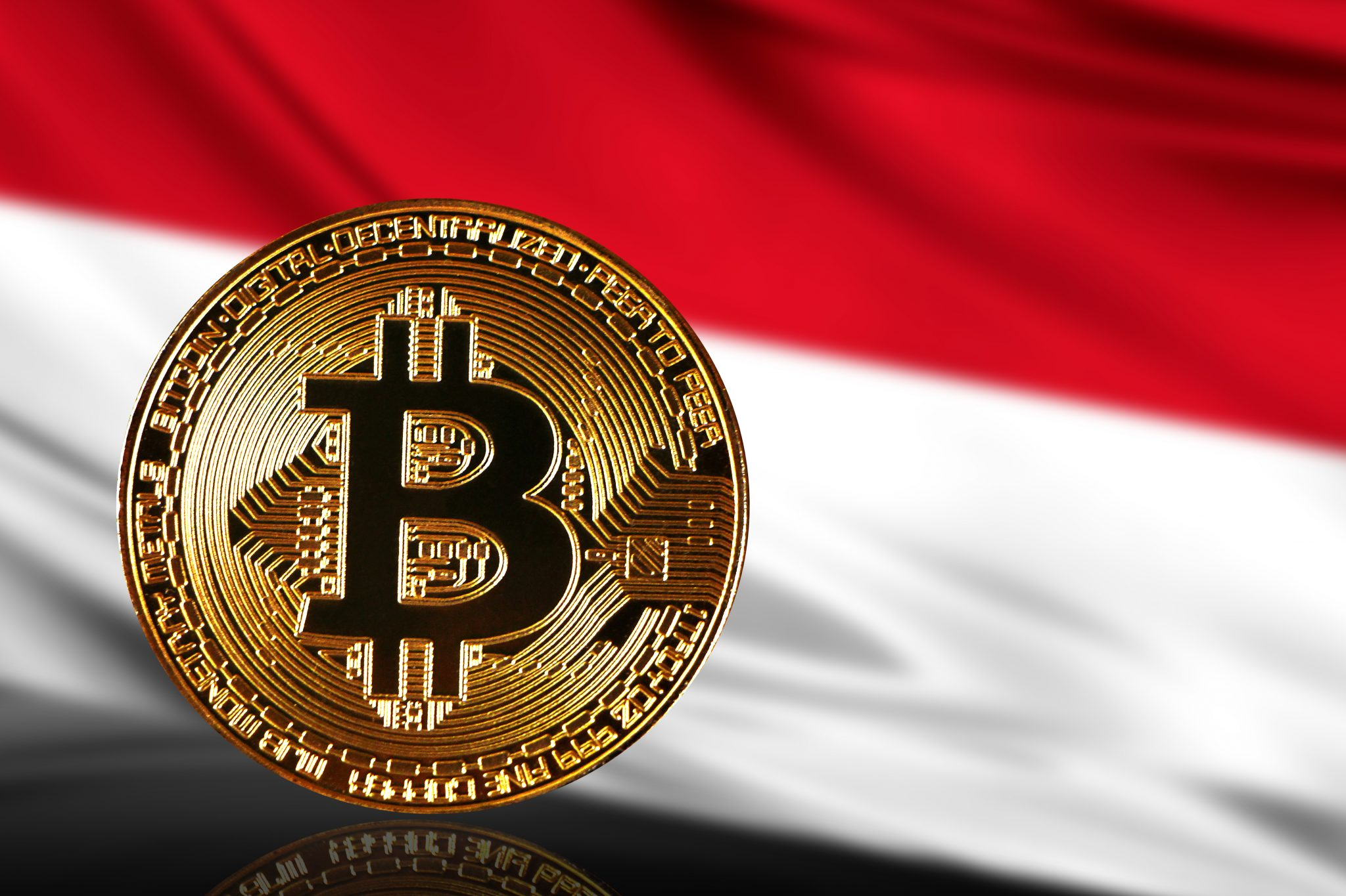 gold coin bitcoin on a background of a flag Indonesia