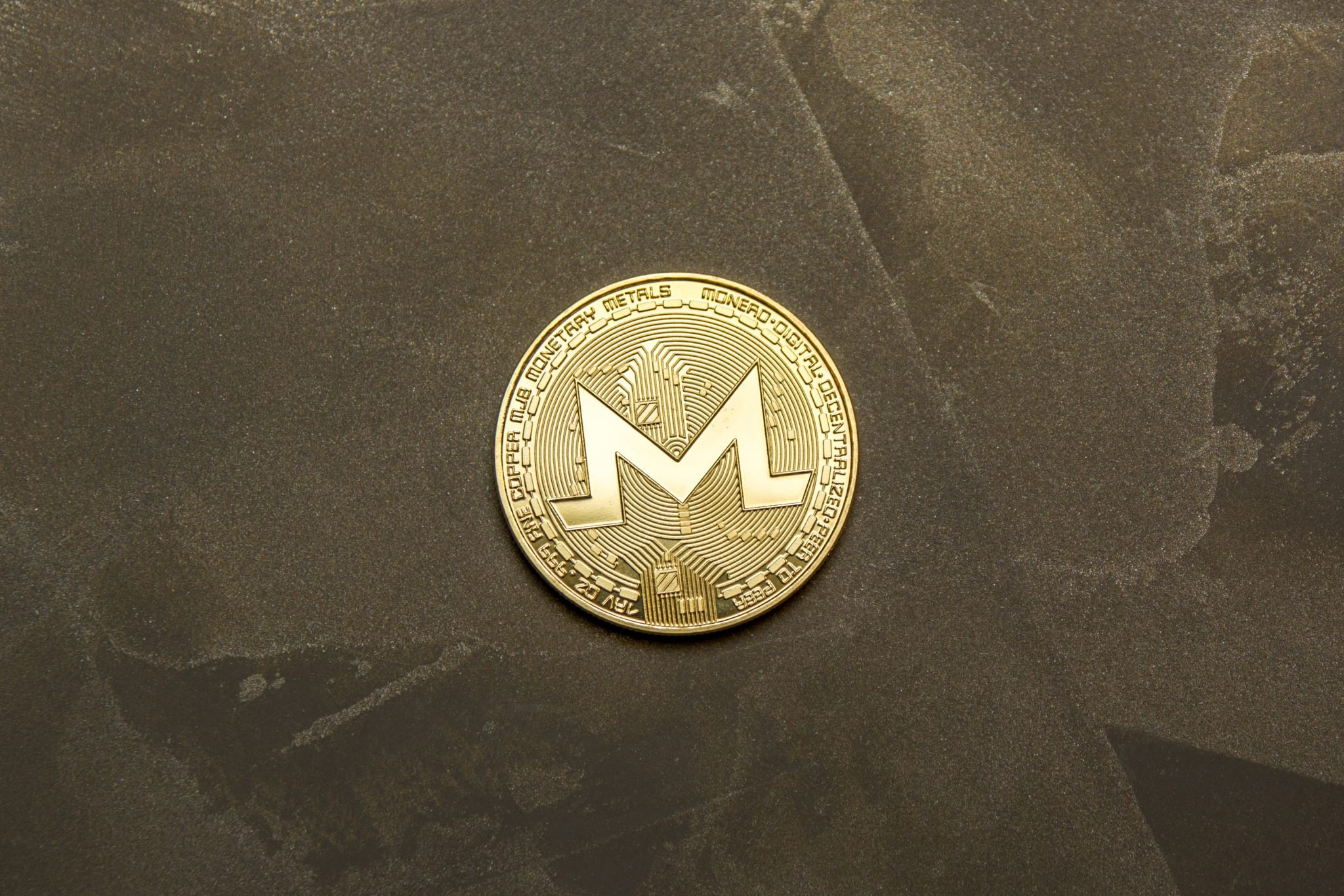 golden monero on background maded from decorative plaster