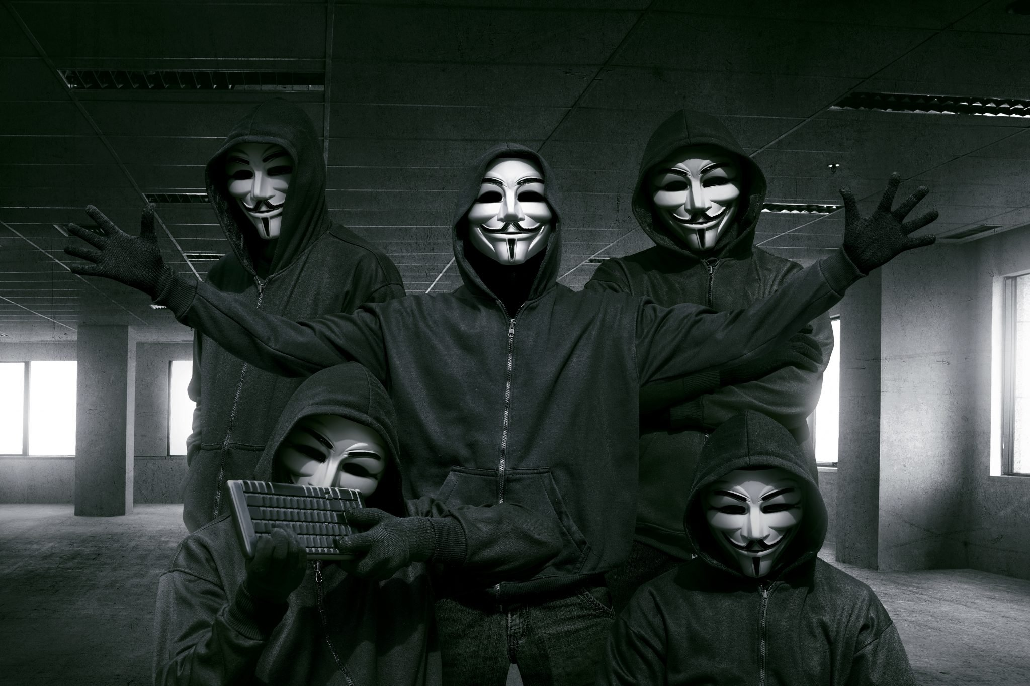 hackers in masks with keyboard