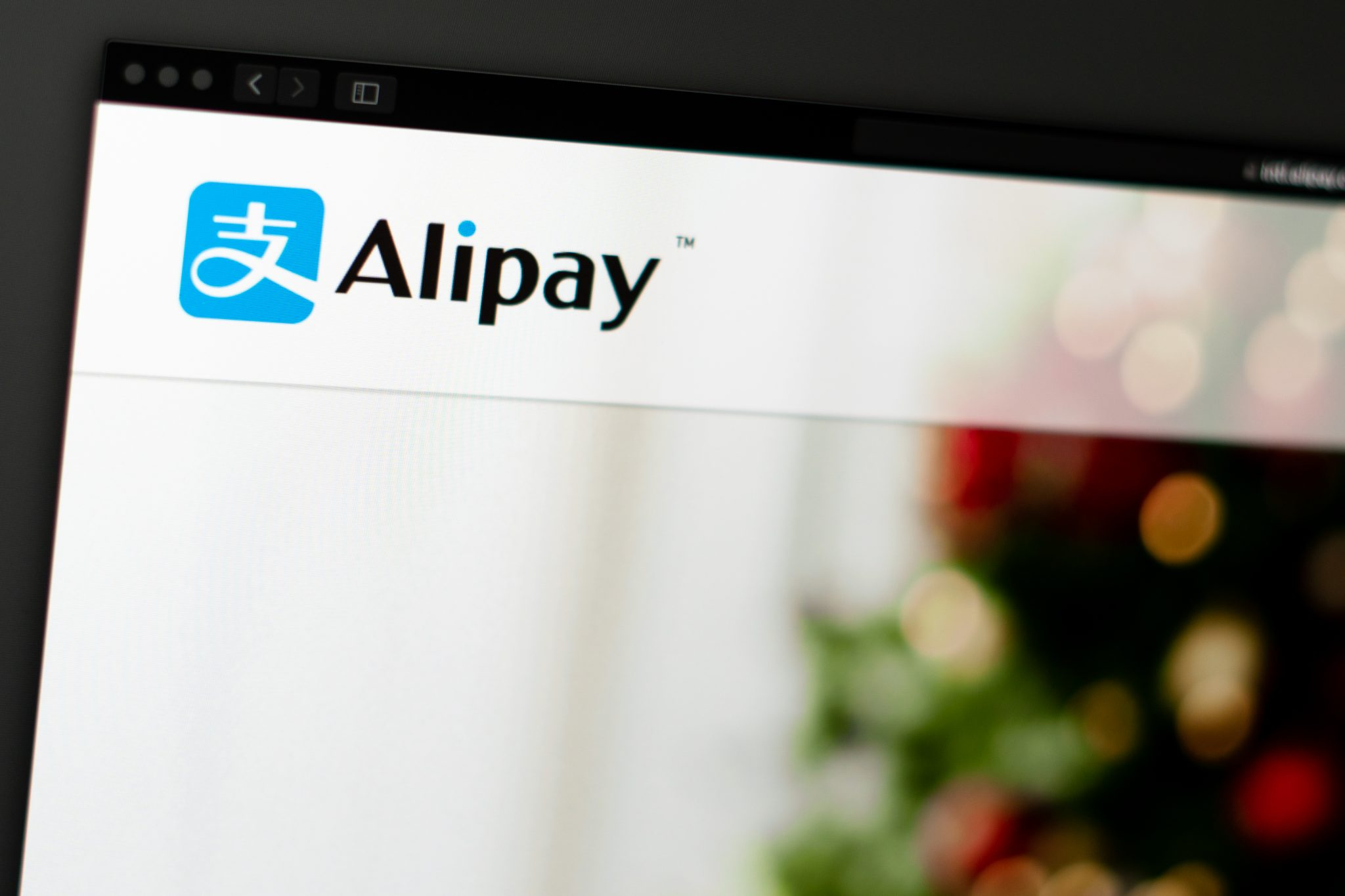 Miami / USA - 04.28.2019: Alipay company website homepage. Close up of Alipay logo. Can be used as illustrative for news media or other websites, good for info, business or marketing concept.