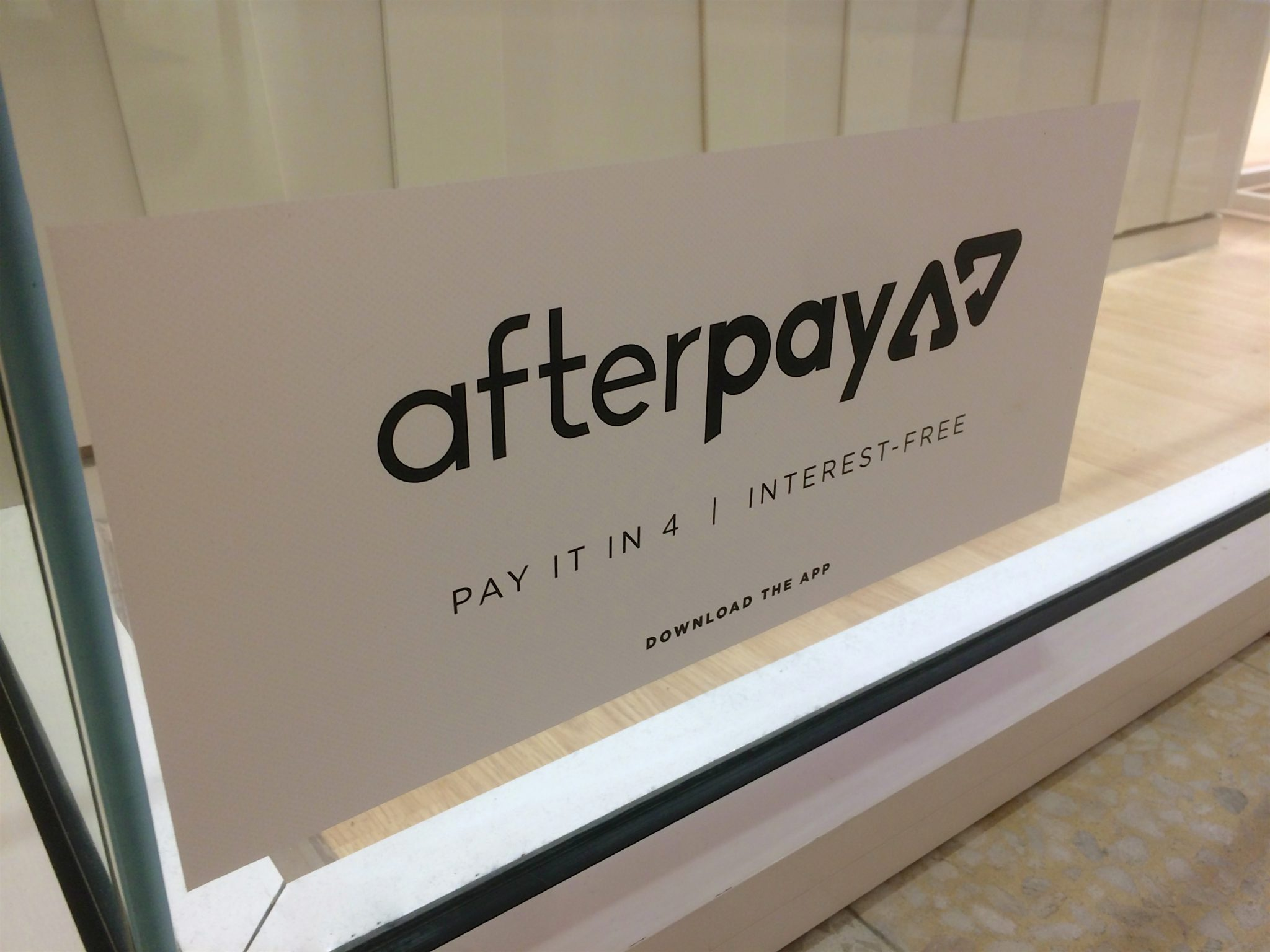 Moorachydore, QLD, Australia - 25th February 2020 : Afterpay App sticker placed on a shopfront window at the Sunshine Plaza Mall. Afterpay is a buy now pay later service provider