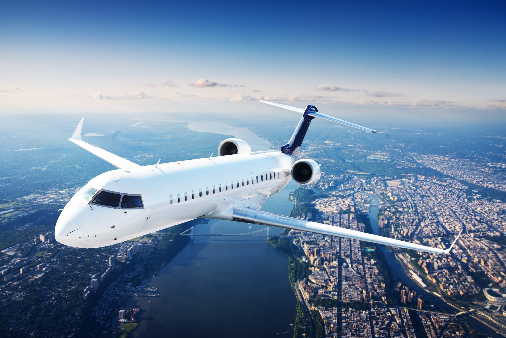 Private jet plane in the blue sky