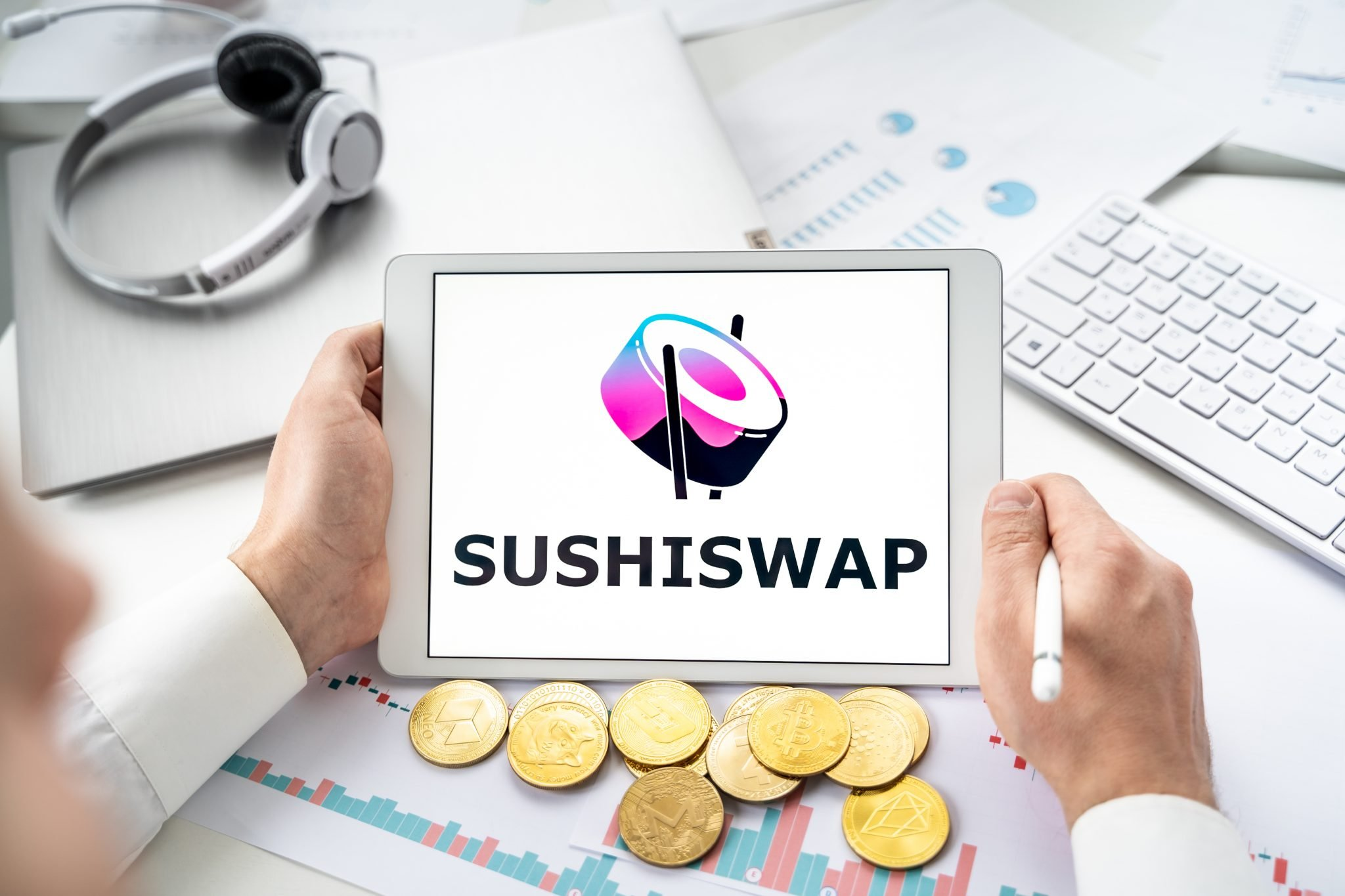 Russia Moscow 06.05.2021 Sushiswap logo.Cryptocurrency decentralized exchange DEX in tablet.Trading blockchain platform to swap,buy,sell crypto token,digital coin Bitcoin,Ethereum.Business,investing.