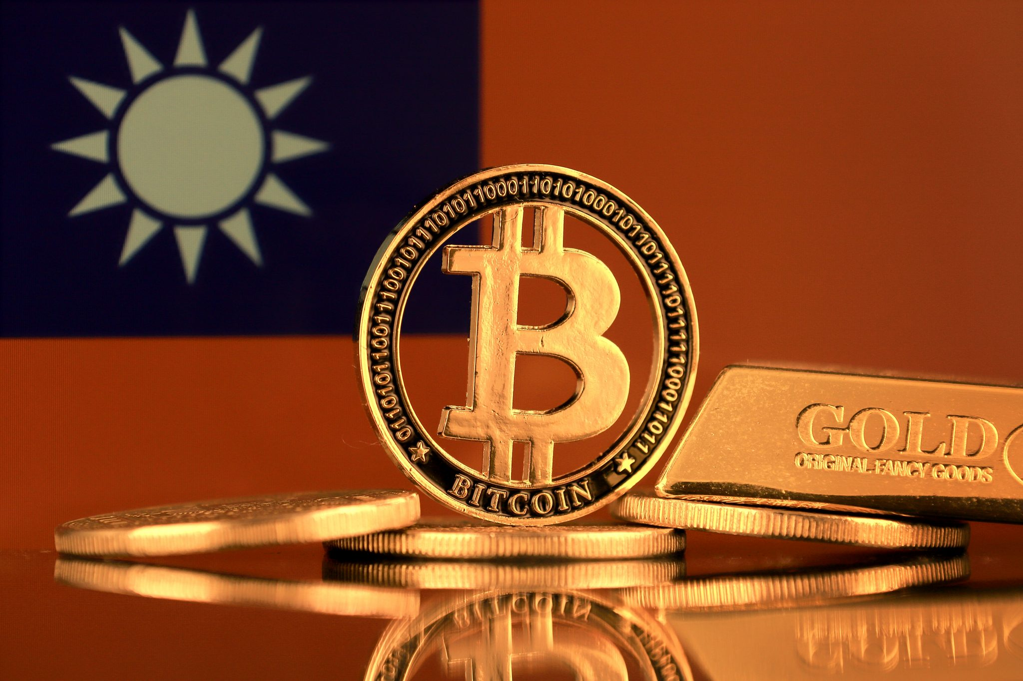 Physical version of Bitcoin, gold bar and Taiwan Flag.